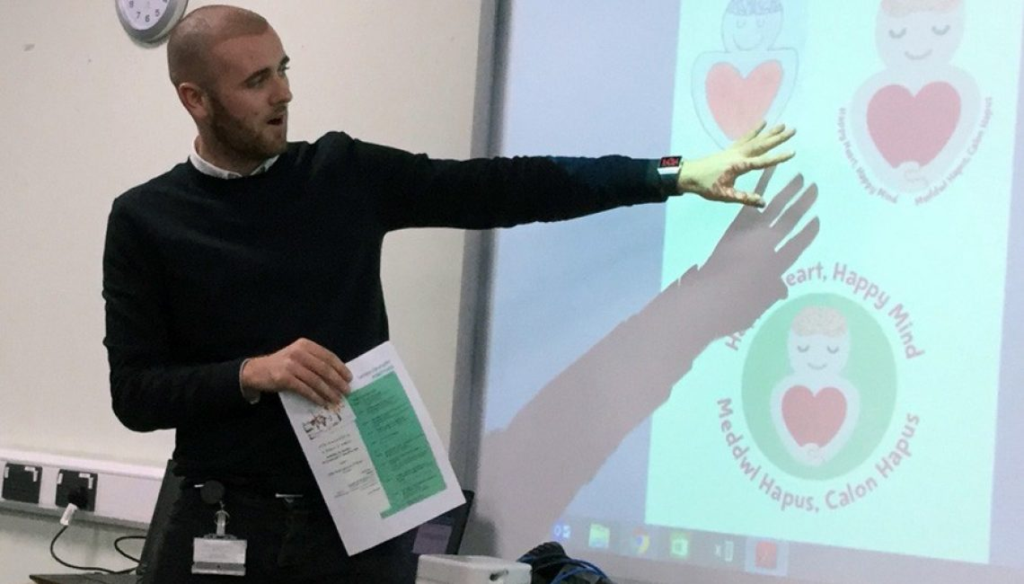 Cllr-Josh-Beynon---presenting-wellbeing-website-to-headteacher-in-Pembrokeshire